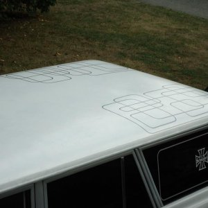 some 70's style pinstriping. Lot more custom paint, like lace painting planned for the roof.