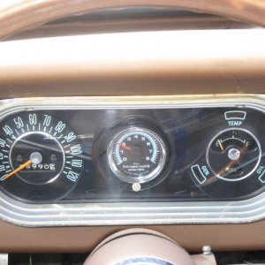 added a sunpro mini tach in the center of my gauge cluster
